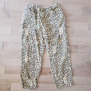 Lili Sidonio distressed leopard print jeans